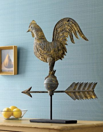 copper rooster weather vane on a table