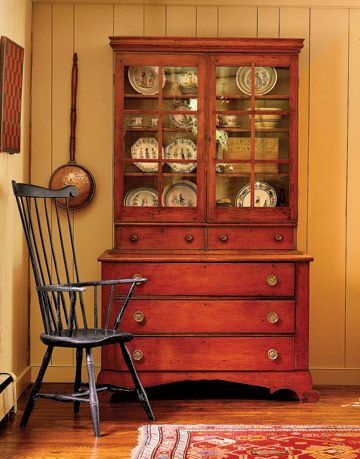 antique cupboard and plates