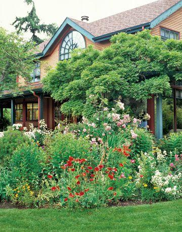 colorful garden near a porch of an orange house