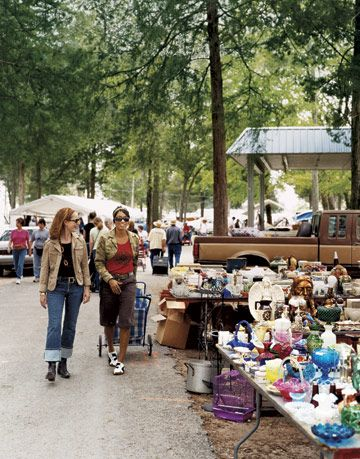 two women walking at a flea market