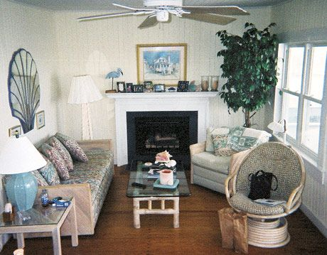 living room with patterned couch and ceiling fan