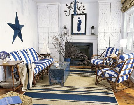 living room with blue and white striped furniture and striped rug