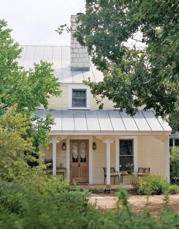 southern country house with porch in wooded area