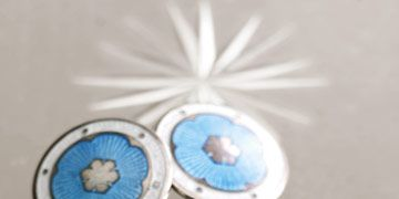 round turquoise and white silver trimmed cuff links