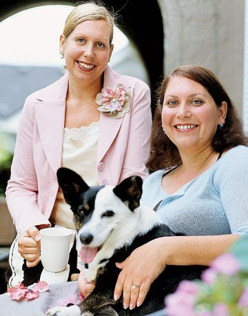 two women smiling with dog