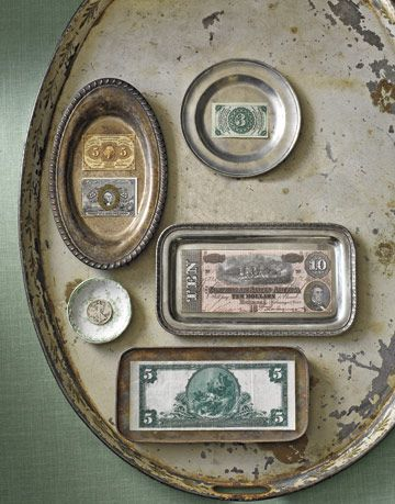 antique early american currency on a rusty metal platter