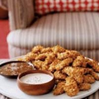 a plate of crispy oven chicken fingers