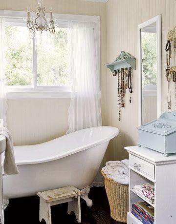 white slipper tub and chandelier