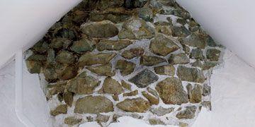 vintage footed tub, exposed stone wall, bathroom design