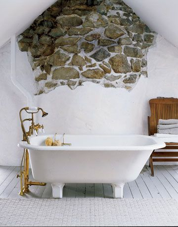 vintage footed tub, exposed stone wall, bathroom design