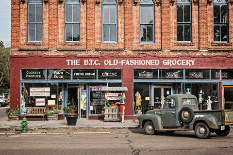 Window, Fender, Commercial building, Town, Classic car, Fixture, Classic, Brick, Mixed-use, Door,