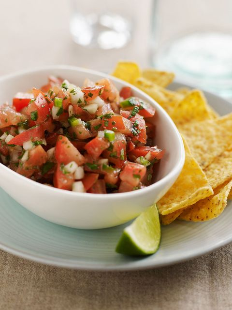 salsa, chips, and slice of lime