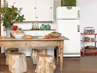 kitchen with wood table white fridge