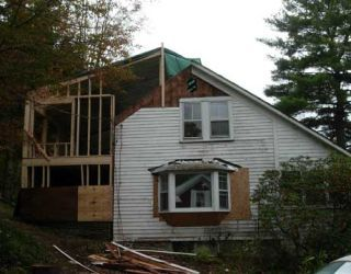Peak Of House Gets Framing In Raised Roof Construction Project