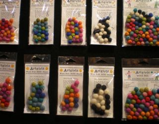 packages of colorful felt balls