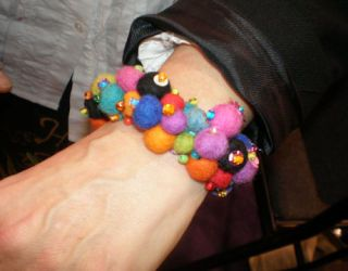 a colorful bracelet with felt beads