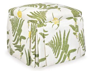white fabric covered ottoman with fern and yellow flower pattern