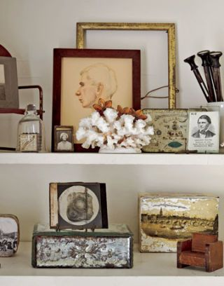 picture frames and various collectibles on a white shelf
