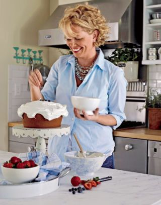 carrie raphael with a cake in the kitchen