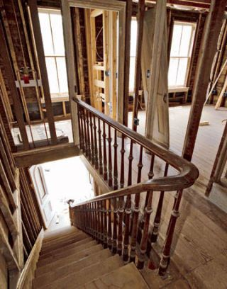 original wooden staircase leading to renovation work upstairs