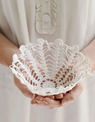 A liquid starch soaked lace doily, shaped into a bowl.