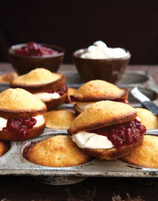 cakes with raspberry jam and whipped cream