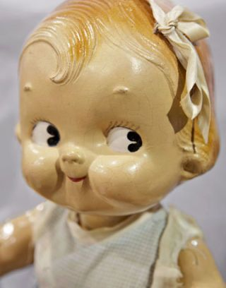vintage baby doll with ribbon in hair
