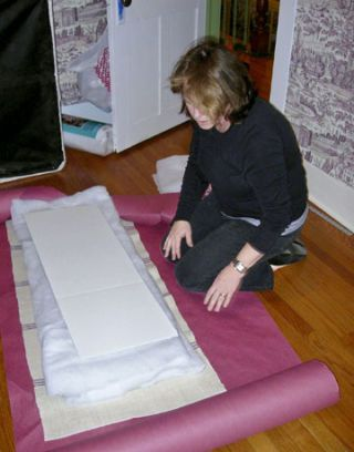 woman on the floor looking at fabric