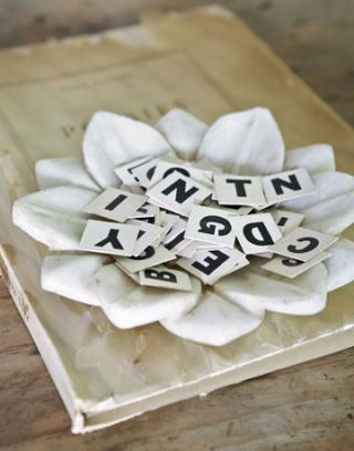white flower dish with letter tiles