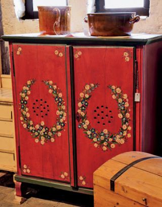 antique red cabinet with painted floral pattern