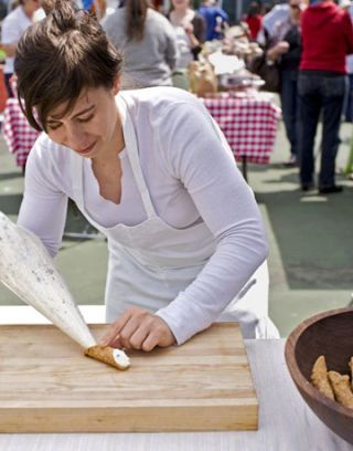 woman making cannoli