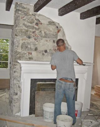 man working on fireplace