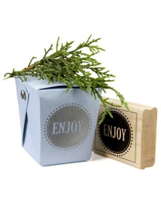blue chinese takeout box with sprig of evergreen