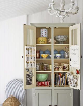kitchen cabinet with pottery