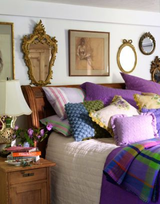 bed with purple linens