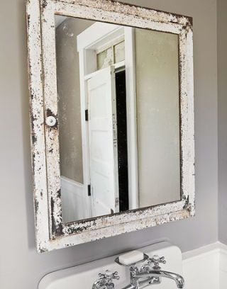bathroom mirror with aged frame