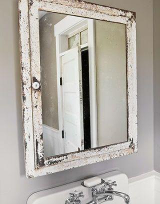 bathroom mirror with aged frame