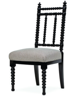 black spindled chair with striped fabric on seat