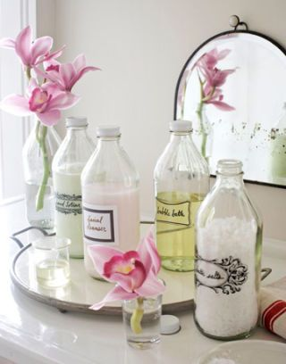 vintage glass bottles with labels on vanity
