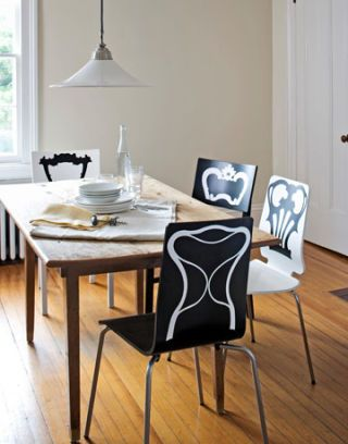 black and white chairs at table with black and white decals