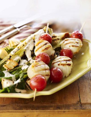 scallop and cherry tomato skewers on plate