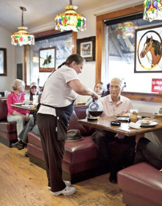 cheerful waitress serves coffee
