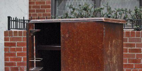 bar cabinet on street sidewalk
