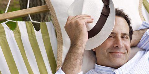 actor tony shalhoub with hat on hammock