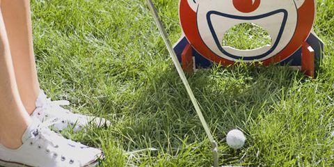 vintage 1950s clown mini golf set girl playing minigolf