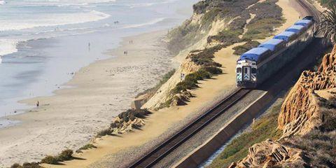 Coastal and oceanic landforms, Transport, Coast, Shore, Horizon, Rolling stock, Ocean, Railway, Sea, Azure,