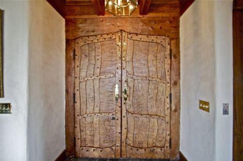 Wood, Hardwood, Wood stain, Home door, Door, Fixture, Tan, Light fixture, Plywood, Door handle,