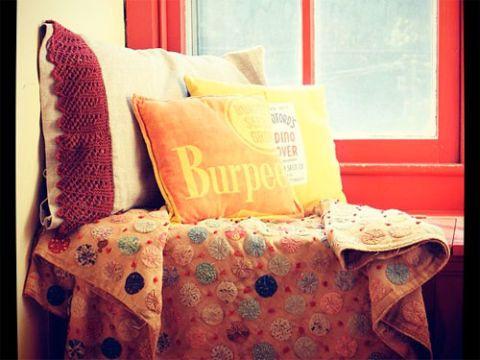 Room, Textile, Interior design, Throw pillow, Pillow, Cushion, Linens, Orange, Home accessories, Bedding,