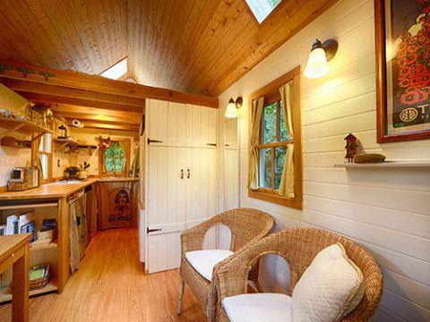 Wood, Lighting, Room, Interior design, Hardwood, Ceiling, Wood stain, Interior design, Picture frame, Cupboard,