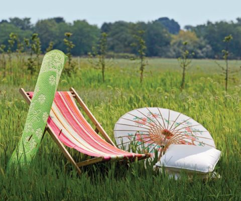 striped sling chair, green run, parasol and pillows